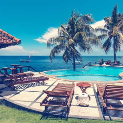 empty-lounges-near-pool-and-ocean-2606523